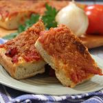 Sicilian Pizza Topped with Tomatoes and Onions